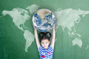A child with long black hair holding the earth above their head, with a simple map of the world spread out behind them, on a sage green background.